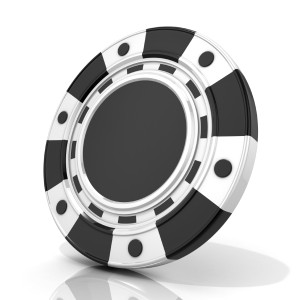 Black gambling chip. 3D render isolated on white